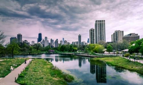 river-near-city-buildings-under-cloudy-sky-1209978