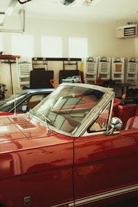red car in a garage 车库里的红色汽车
