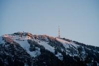 snow covered mountain during daytime 白雪皑皑