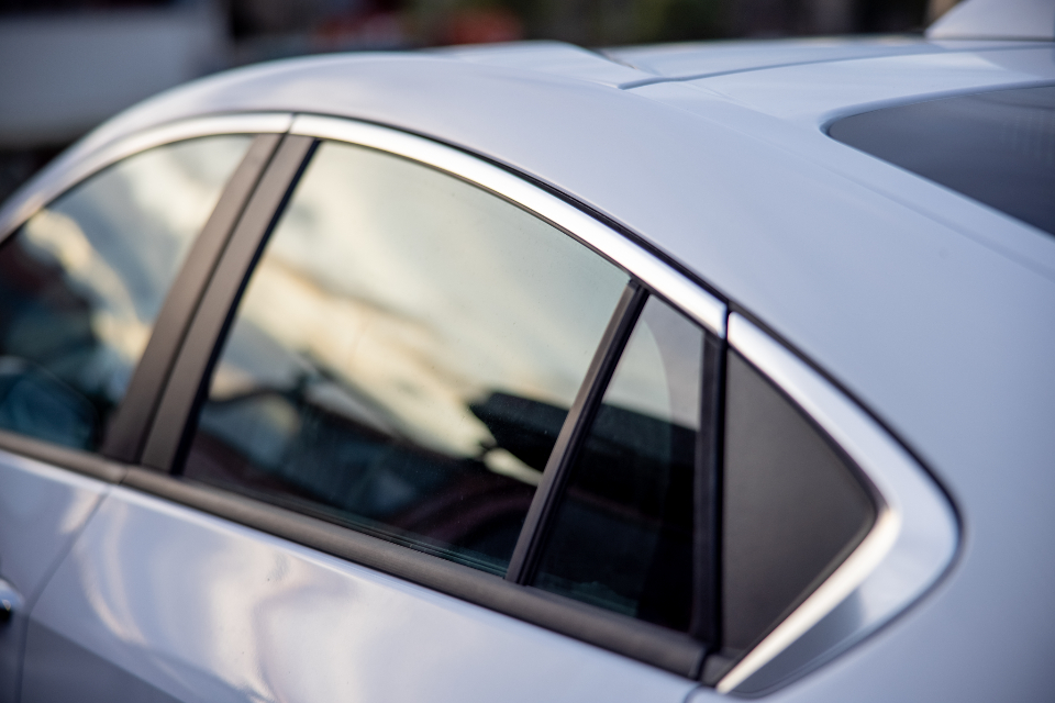 auto window car detail sedan exterior paint design vehicle outdoor automobile transport transportation travel reflection view drive journey luxury trip light glass sky background reflection