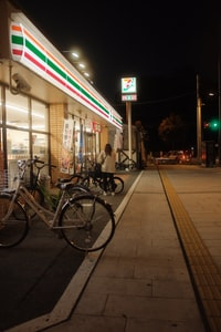 bicycles parked beside the road during night time