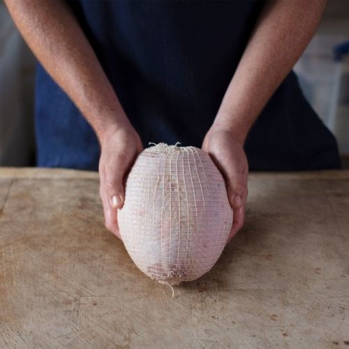 Raw Netted Turkey Breast Skin on Oven Ready